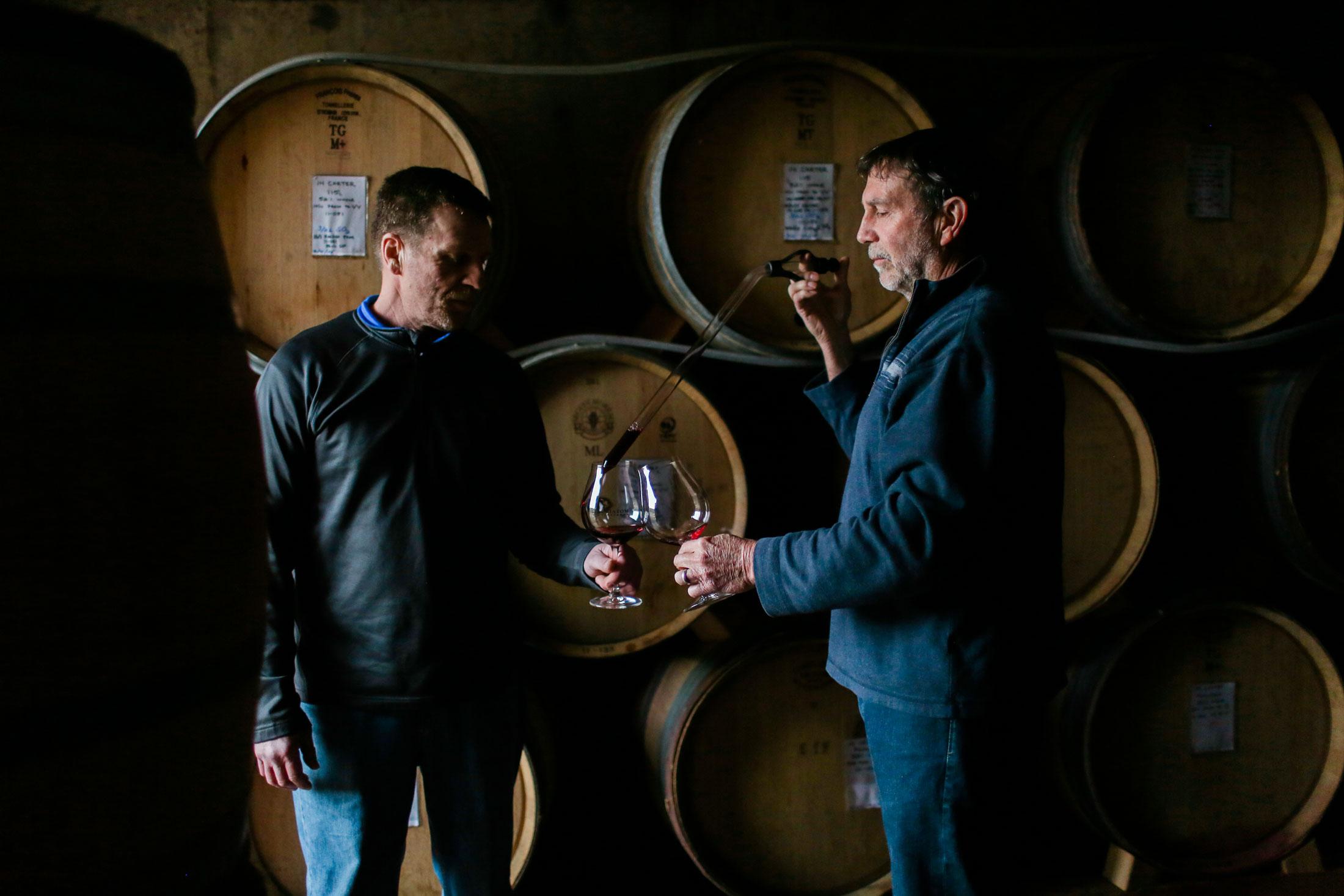 Winemakers taste wines in the cellar at Cristom Vineyards