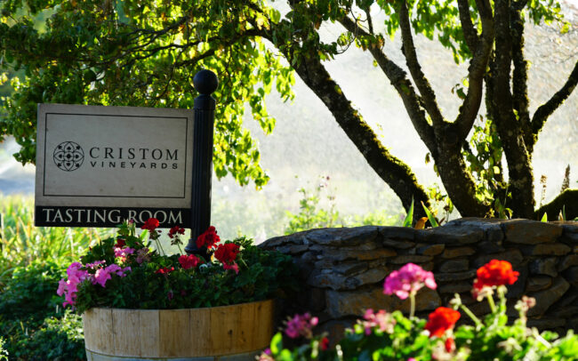 Cristom Vineyards tasting room sign and flowers